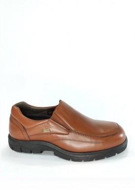 Zapato estilo mocasín con elásticos laterales. Marrón claro. Piso goma. Tubolari.