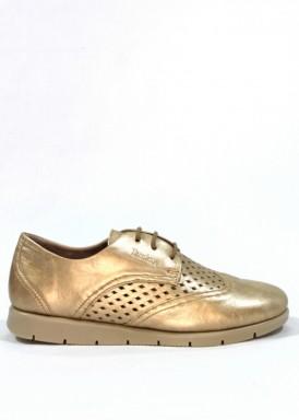 Zapato deportivo mujer de piel suave, cordón, modelo oxfor. Piso flexible. Dorado. TAMICUS