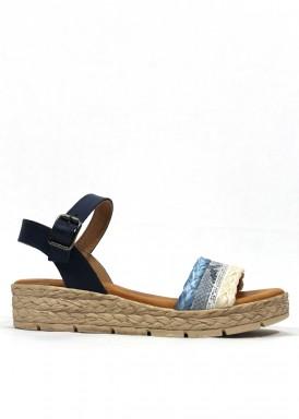 Sandalia de piel y rafia de piso plano alto. Color azul y beis. XQSI.