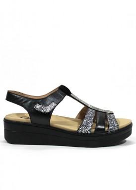 Sandalia de piel de velcro. Ancho especial. Color negro y blanco. Ana Román